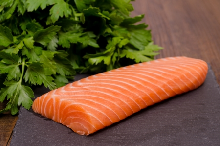 Salmon and parsley on slab slate photo