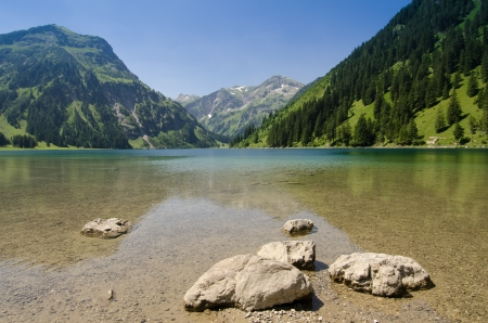 Postcard picture of a lake and mountain in Austria Tirol photo