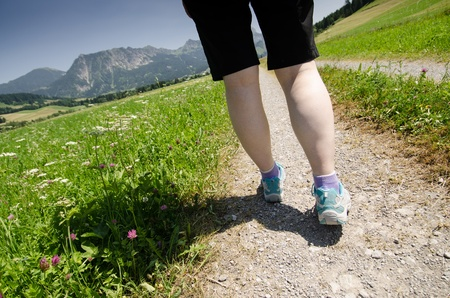 Hiking on a way with meadow and flowers in Tirol Austria photo
