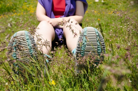 allgau: Woman is sitting in a alpine meadow with flowers and have a break