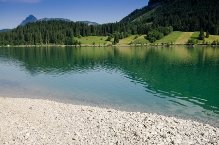 Lake Haldensee in Tirol Austria with turquoise water photo