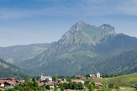 allgau: Village Grän in Tirol with mountain Aggenstein and blue sky Stock Photo