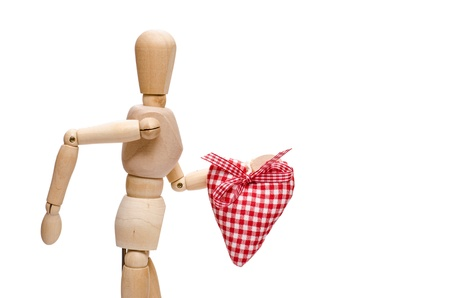 unclothed: Male wooden figure is holding a red checkered heart