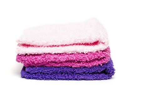 washcloth: Stack of different colored washcloth of terry cloth