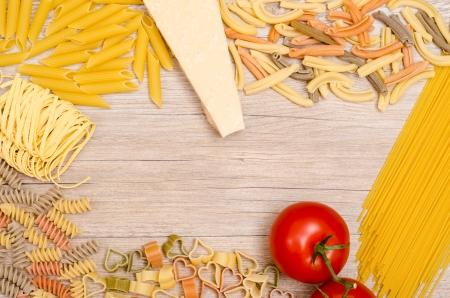 durum wheat semolina: Italian pasta with tomato and parmesan cheese on wooden table