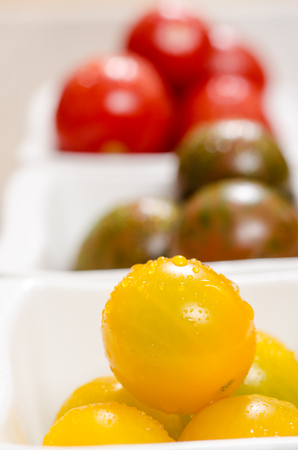 vertical format: Close up yellow tomato in vertical format Stock Photo