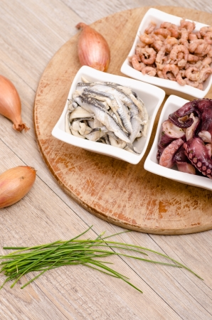 vertical format: Seafood as appetizer with onions and chives in vertical format