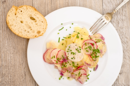 Potato salad with veal sausages, radishes and chives Stock Photo - 22707014