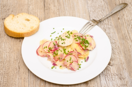 Potato salad on a white plate with white bread and a fork Stock Photo - 22707016