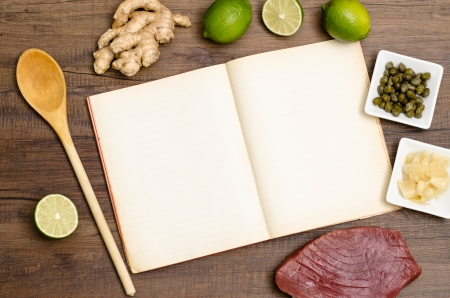Recipe book, wooden spoon and ingredients and text space Stock Photo