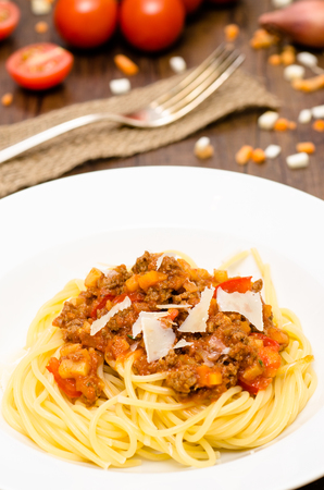 vertical format: Spaghetti bolognese with minced meat sauce in vertical format