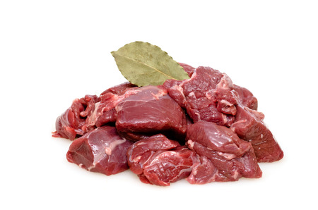 bay leaf: Raw venison from deer as goulash with bay leaf Stock Photo