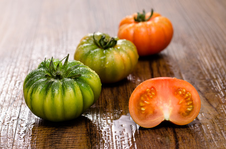 bue: Green and red bovine heart tomatoes Coure di Bue Stock Photo