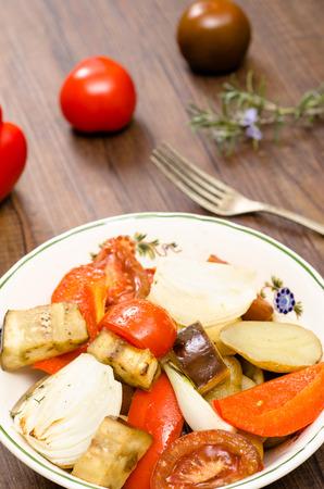 vertical format: Roasted vegetable in a porcelain bowl in vertical format