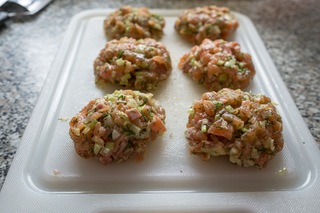 Burger with raw smoked salmon, celeriac and herbs Stock Photo