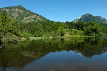 Lake Moorweiher with peak Schattenberg and Riffenkopf in Summer Stock Photo