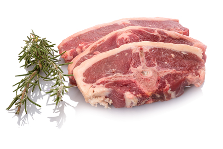 Lamb meat raw red with green herbs rosemary white isolated Standard-Bild