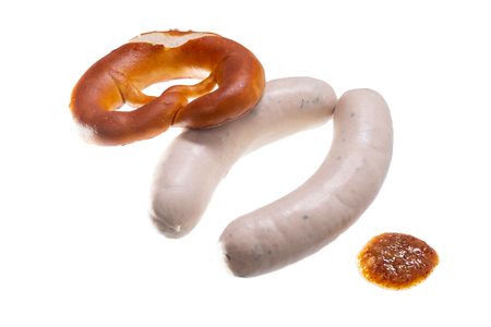 Bavarian veal sausages Weisswurst mit mustard and pretzel white isolated Imagens