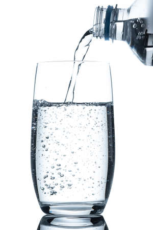 Glass of mineral water with carbonic acid air bubbles pouring in