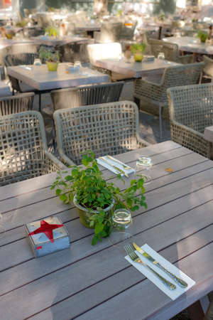Tables with cover and herbs outdoor in vertical format