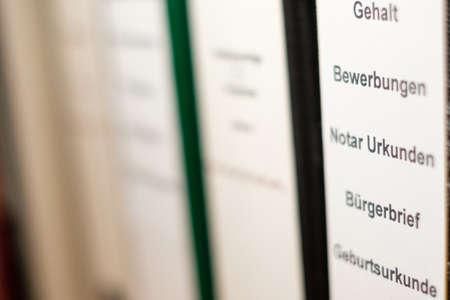 File in rack blurred close-up