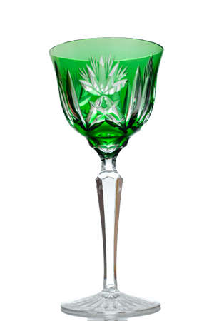 Crystal wine glass in green and back lit vertical format