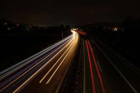 Red white blue car light trails on a road highway blurred motion Stok Fotoğraf