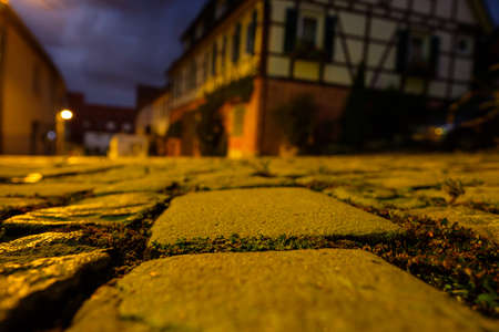Cobblestones road with half-timber houses in the night light