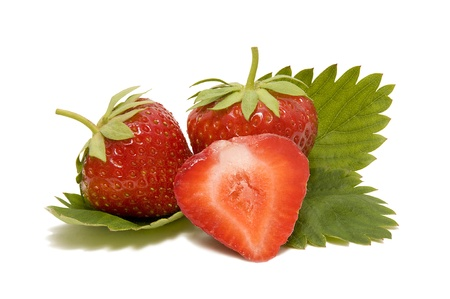 red ripe strawberries with leaves on a white background photo