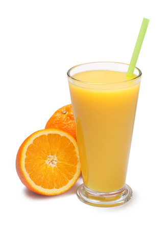 freshly squeezed orange juice in a glass with orange fruits on a white background