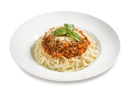 pasta bolognese  with basil on a plate on a white background