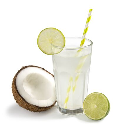 coconut water in a glass with a slice of lime on a white background