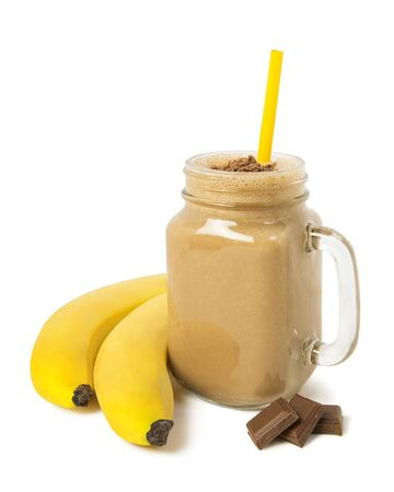 Banana chocolate smoothie in a glass jar with ingredients Isolated on a white background