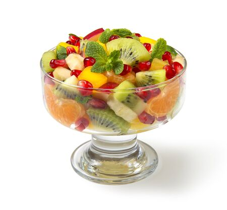 Winter fruit salad in glass salad bowls on white background. Selected focus.