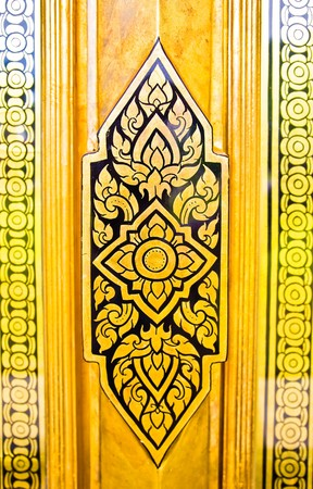 Lai Thai, carved church door. photo