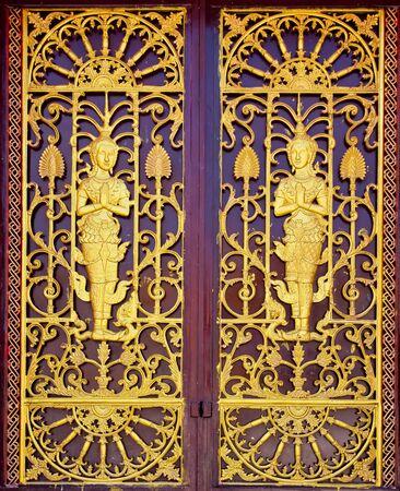 Lai Thai, carved church door. photo
