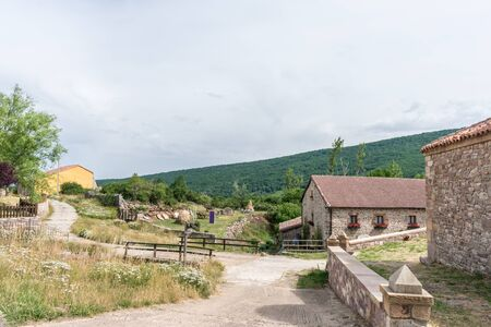 street of a mountain village in Spain with stone houses in summer
