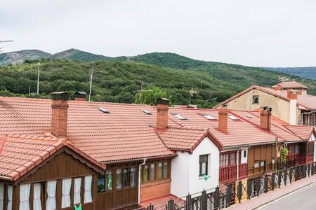 row of wooden village houses with mountain village in Spain