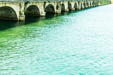 stone bridge with several eyes crossing the bay in Pontedeume in Coruna in Spain