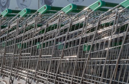 supermarket trolley: a lot of a supermarket trolley with green handels Foto de archivo