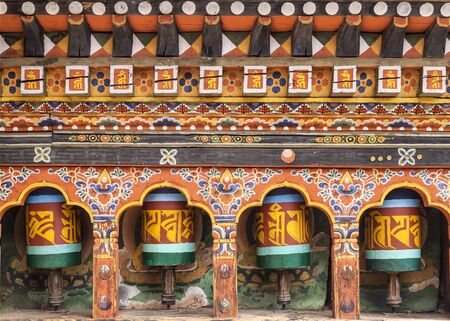 Turning prayer wheels mantra in Bhutan with traditional writing mantra which sounds as