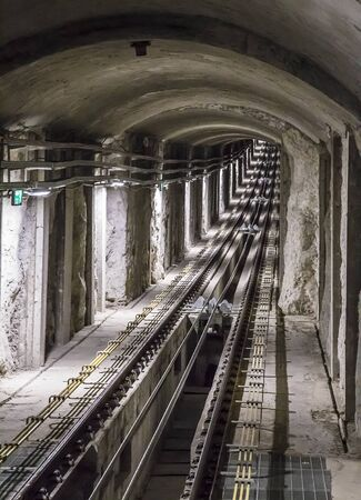 The Carmelit an underground funicular railway, one of the smallest subway systems in the world, having only four cars, six stations and a single tunnel 1.8 km long. Haifa, Israel