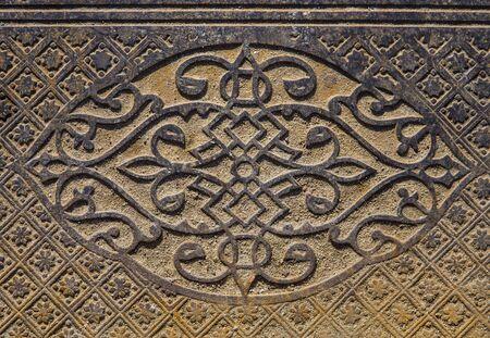 Beautiful pattern on the vintage metal floor paving pile outdoors.