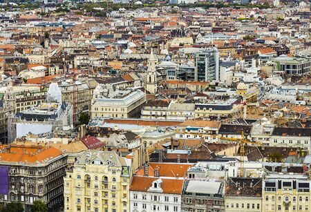 Historical downtown of Budapest, Hungary, Europe from above, aerial view. Rooftop view with old town buildings, church towers, rooftops, construction cranes. European capital city Budapest skyline.