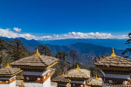 108 Memorial Chortens of Dochula Pass- mountain pass in Himalayas within Bhutan on the road from Thimpu Thimphu to Punakha, Bhutan.