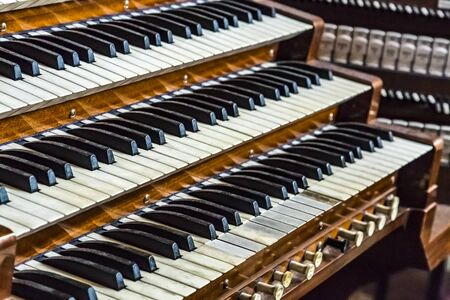 Close up of ancient pipe organ keyboards in european cathedral Foto de archivo