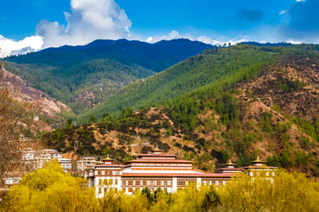 Building of the National Assembly of Bhutan in traditional style in the capital Thimphu against the foothills of Himalayas in spring. This is the elected lower house of Bhutan bicameral Parliament.