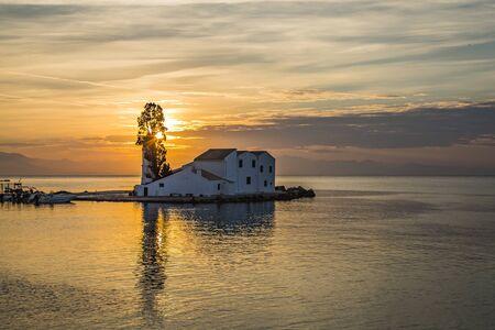 Early morning sunrise view of famous Vlachern? monastery, Pontikonissi or mouse island and fisherman boats in Halikiopoulou lagoon. Kanoni, Corfu island, Greece. Daybreak down. Selective focus Stock Photo