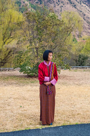 Thimphu/Bhutan - February 2016: Young Bhutanese girl in traditional women dress named kira, wonju (long-sleeved blouse) and a short jacket toego.