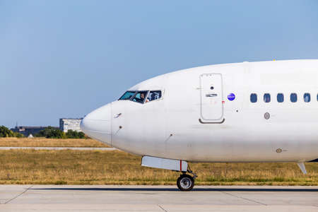 Kharkov / Ukraine - August 19, 2018: Nose of Airbus A319 closeup of FANair in Kharkov Airport, pilot in the cockpit